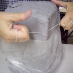cutting gray clay